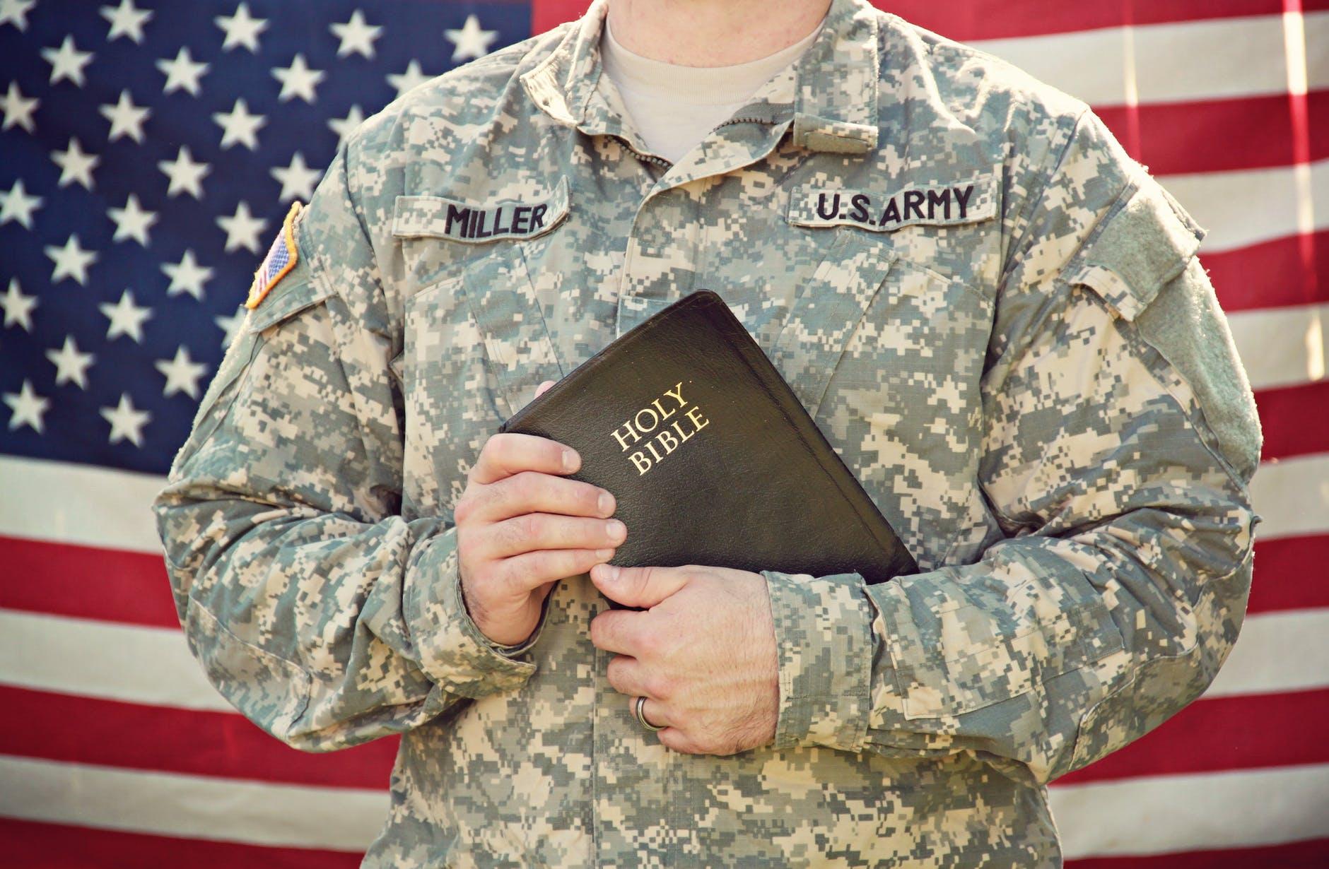 man holding bible